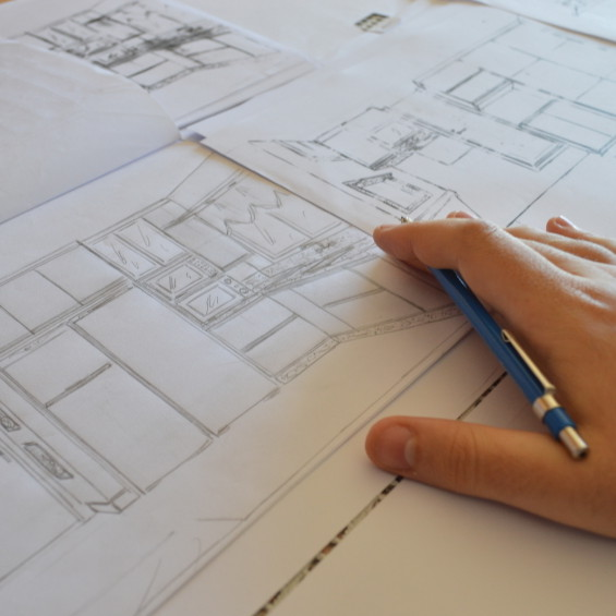 Male Architect's Hand Holding Mechanical Pencil on a Residential Blueprint